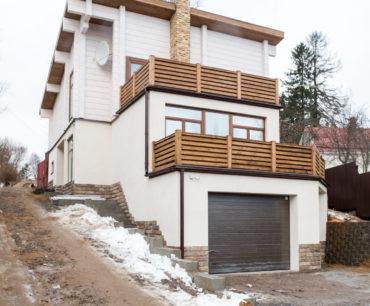 Комбинированный дом из бетона и клееного бруса